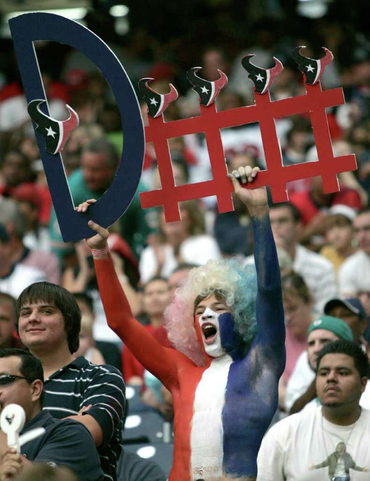 BRETT COOMER: CHRONICLE SHOW US A SIGN: Texans fans hope an offseason full of defensive upgrades pays off.