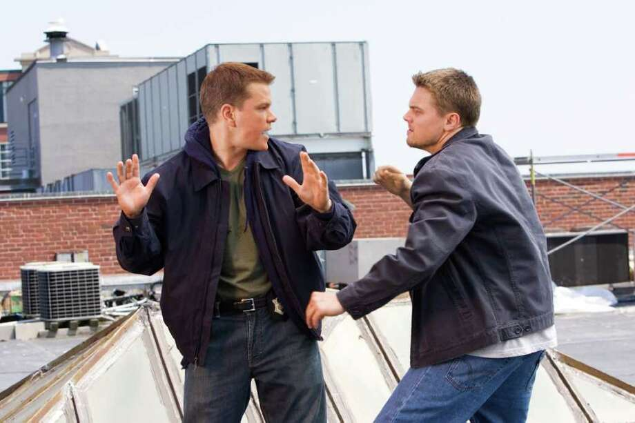 "Matt Damon, left, and Leonardo DiCaprio in a scene from ""The Departed.""  Photo: ANDREW COOPER, HO / WARNER BROS. ENTERTAINMENT"