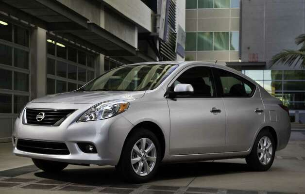 Prices for the redesigned 2012 Nissan Versa subcompact sedan begin at $10,990 (plus freight), which brings a five-speed manual gearbox. COURTESY OF NISSAN NORTH AMERICA INC. Photo: Nissan North America, COURTESY OF NISSAN NORTH AMERICA INC.