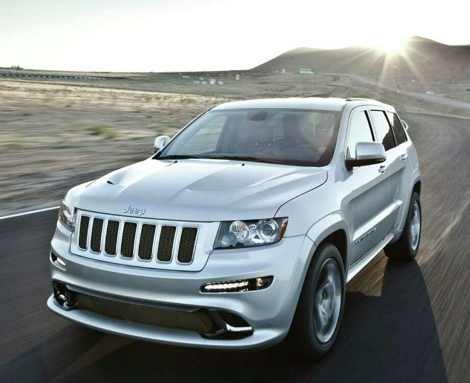 New for 2012 is the SRT8 performance version of the Jeep Grand Cherokee, with a 470-horsepower, 6.4-liter V-8 engine and a price of $54,470. COURTESY OF CHRYSLER GROUP LLC Photo: Chrysler, COURTESY OF CHRYSLER GROUP LLC