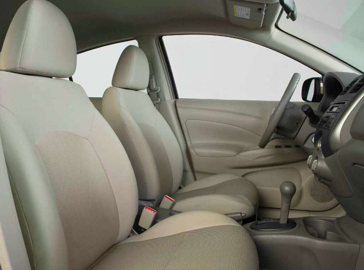 Bucket seats are standard in the front of the roomy 2012 Nissan Versa subcompact sedan, which comes with either a manual or continuously variable automatic transmission. COURTESY OF NISSAN NORTH AMERICA INC.