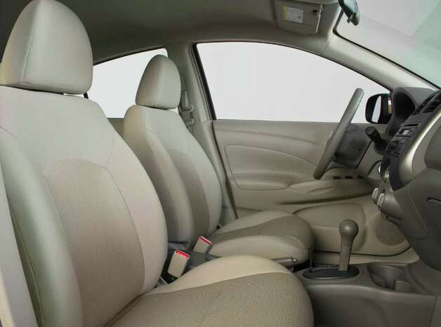 Bucket seats are standard in the front of the roomy 2012 Nissan Versa subcompact sedan, which comes with either a manual or continuously variable automatic transmission. COURTESY OF NISSAN NORTH AMERICA INC. Photo: Nissan North America, COURTESY OF NISSAN NORTH AMERICA INC.