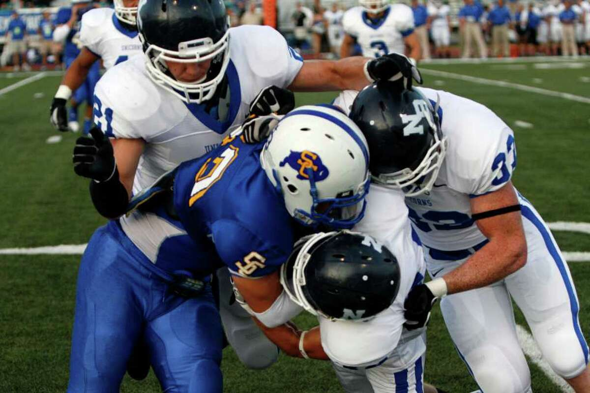 Clemens running back Anthony Matthews is gang-tackled by several New Braunfels Unicorn defenders during Friday's home opener for the Buffaloes, a 23-7 loss.