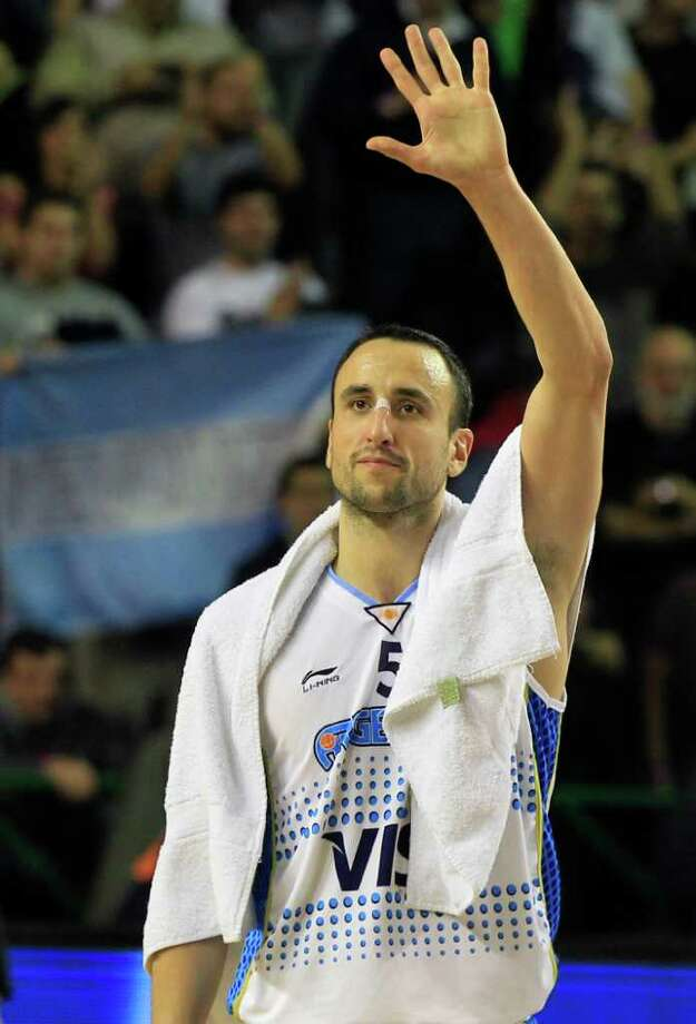 Argentina's Manu Ginobili waves to fans after his team's 84-58 victory over the Dominican Republic during a FIBA Americas Championship basketball game in Mar del Plata, Argentina, Thursday, Sept. 8, 2011. The top two finishers of the tournament get an automatic berth in the 2012 London Olympics and the next three advance to the last-chance Olympic qualifier to be held in July 2012. Photo: Martin Mejia/Associated Press