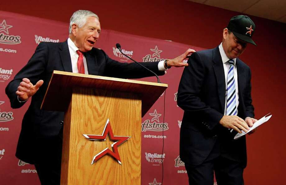 Jim Crane, right, will get a $70 million discount to buy the Astros from Drayton McLane and move the club to the American League. Photo: Karen Warren, Staff / © 2011 Houston Chronicle