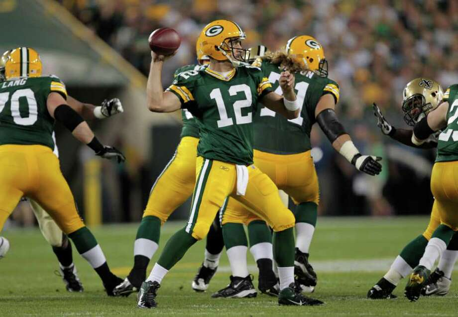 Packers quarterback Aaron Rodgers threw for 312 yards and three touchdowns. Photo: Mike Roemer, Associated Press / FR155603 AP