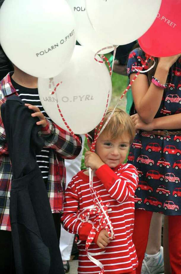 Dima Athanason, 3, models fashions from Polarn O. Pyret during the Fashion's Night Out red carpet event on Greenwich Avenue on Thursday, Sept. 8, 2011. Photo: Amy Mortensen / Connecticut Post Freelance