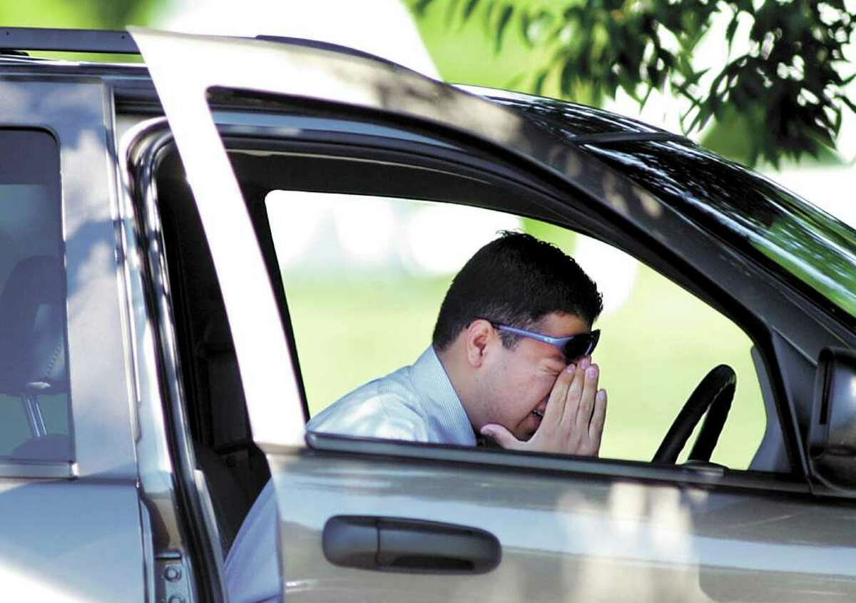 Sergio Paniaqua, sitting in his vehicle at Greenwich Point on Sept. 11, 2001, cries as he listens to the radio and the news of terrorist attacks.