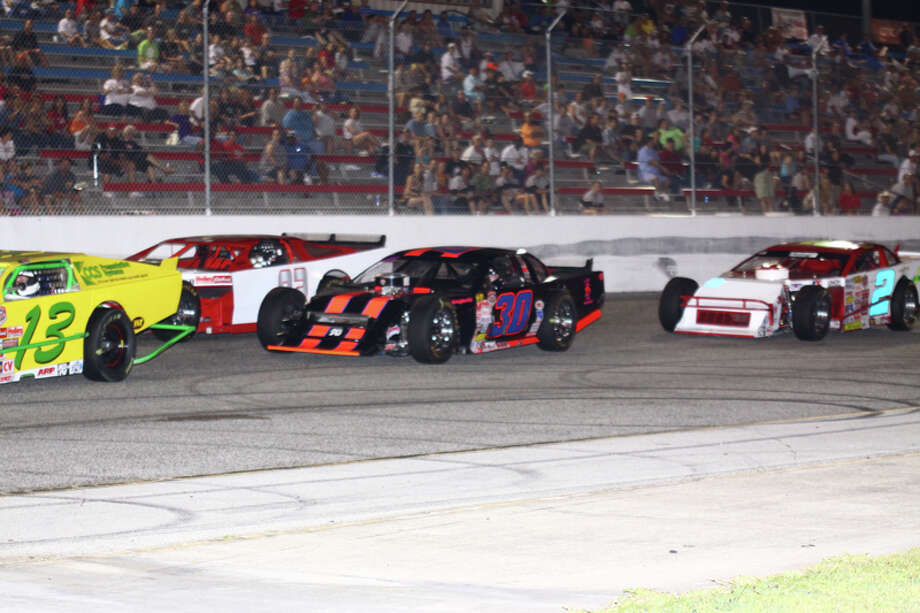 STEVE STEINLE: FOR THE CHRONICLE DIFFERENT KIND OF RACE: Jake Kruger, driving the No. 30 in traffic during a recent NASCAR Fiesta Modified race at Houston Motorsports Park, and his family lost their home in Bastrop to the wildfires raging in the area. Photo: Handout