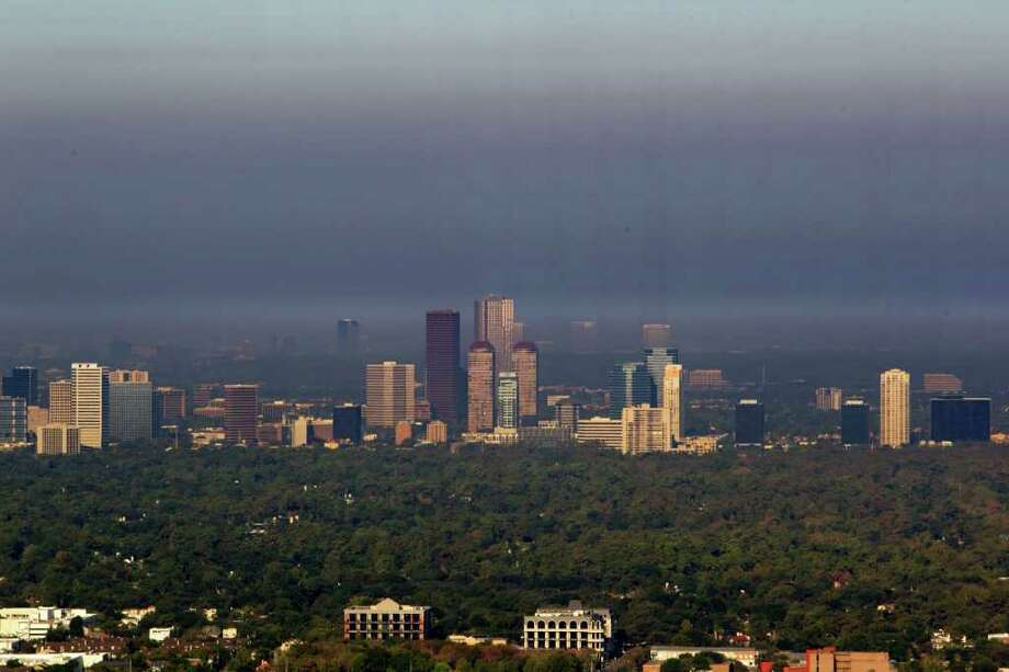 A smoky haze from wildfires hangs over the Galleria area skyline Thursday. Photo: James Nielsen, Staff / © 2011 Houston Chronicle