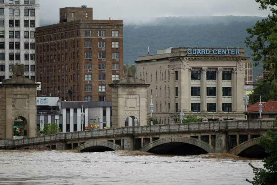 The swollen Susquehanna River rises against Market Street Bridge, Thursday, Sept. 8, 2011, in Wilkes