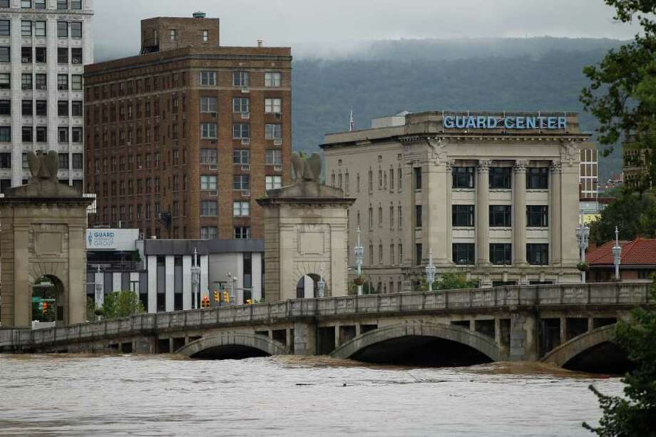 The swollen Susquehanna River rises against Market Street Bridge, Thursday, Sept. 8, 2011, in Wilkes-Barre, Pa. Widespread flooding brought on by the remnants of Tropical Storm Lee was being blamed for two deaths in Pennsylvania, where inundated communities were evacuated and state offices closed down on Thursday because of the rising waters. (AP Photo/Matt Rourke) Photo: Matt Rourke