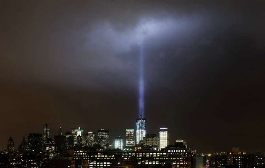 A test of the Tribute in Light rises above One World Trade Center and lower Manhattan, Thursday, Sept. 8, 2011 in New York. (AP Photo/Mark Lennihan) Photo: Mark Lennihan