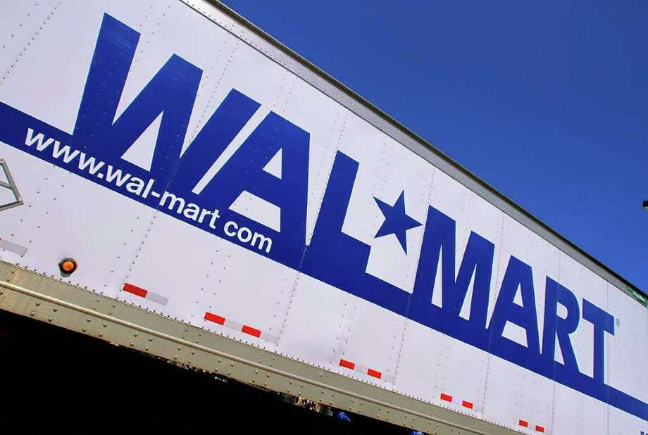 FILE - In this May 16, 2011 file photo, the Wal-Mart logo is displayed in Springfield, Ill. Wal-Mart is bringing back something it avoided during the Great Recession: layaway. Wal-Mart's layaway will kick off Oct. 17 and run through Dec. 16, but the company said it may extend the option throughout the year if the program is successful. (AP Photo/Seth Perlman, File) Photo: Seth Perlman