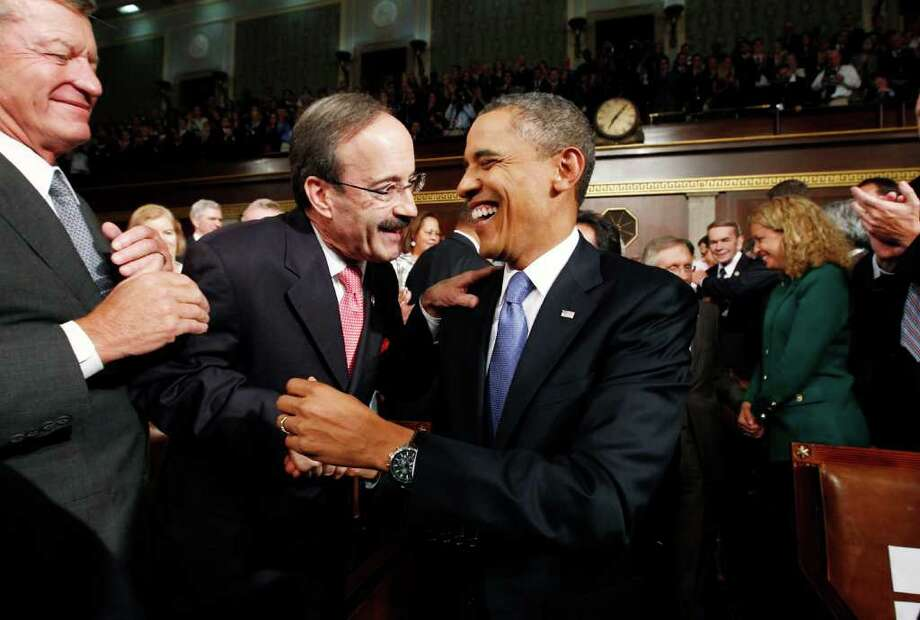 President Obama laughs with Rep. Eliot Engle, D-NY., as he enters to address a joint session of Congress on Capitol Hill in Washington, Sept. 8, 2011.       (AP Photo/Kevin Lamarque, POOL) Photo: KEVIN LAMARQUE
