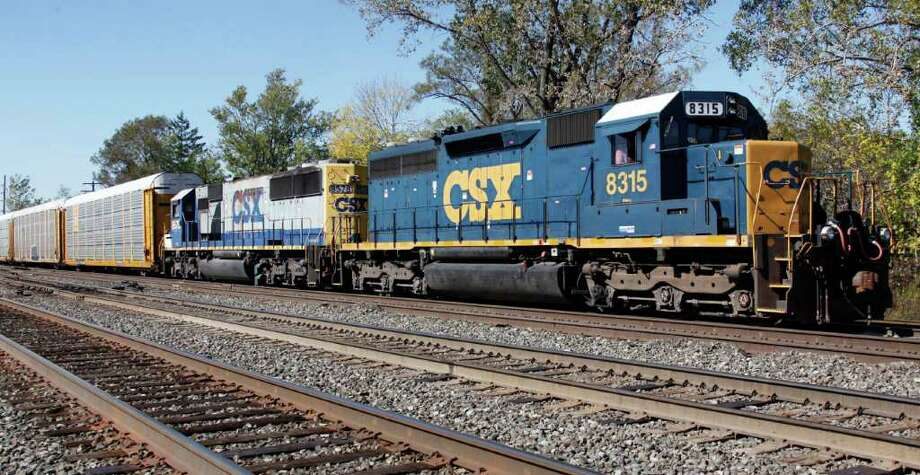 In this photograph taken Oct. 7, 2010, a CSX train rolls along the tracks in Buffalo, N.Y. CSX Corp. discloses its quarterly financial results Tuesday,  Oct. 12, after the market close. (AP Photo/David Duprey) Photo: David Duprey / AP