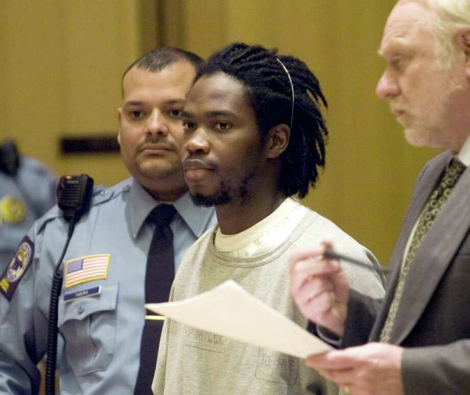 FILE — Kevin Wilson, pictured here when he was arraigned in 2009 on charges he killed 26-year Jonathan Green, pleaded guilty to one count of murder on Thursday, September 8, 2011, agreeing to spend 35 years in prison. Green was found dead in September 2008 in a grassy lot in Stamford's South End. Wilson, 21, of Samson Street in Bridgeport, was arraigned on murder charges in 2009. Photo: Desmarais,Paul, ST / 00009429A