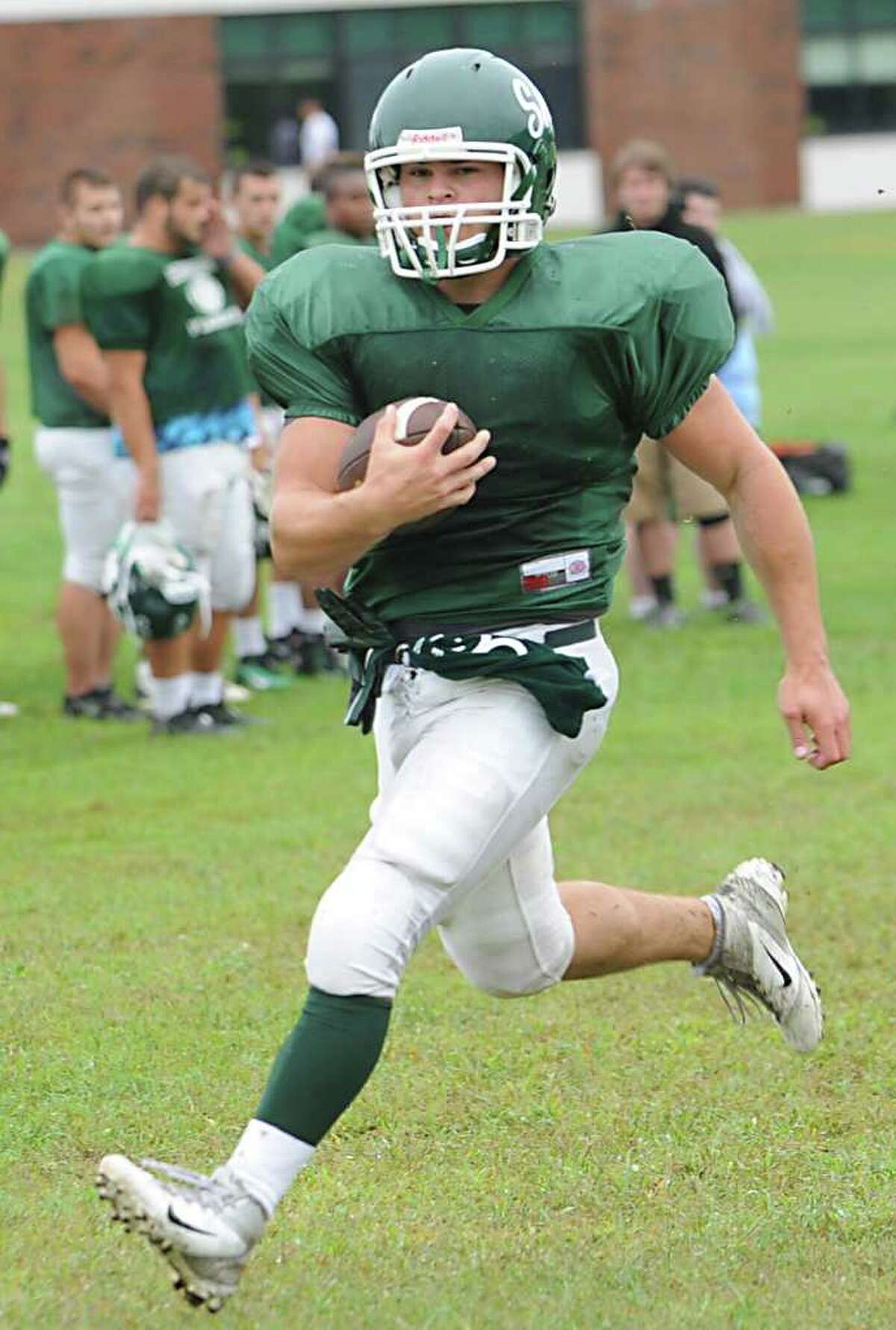 Shenendehowa running back Tony Fusco runs with the ball during practice in Clifton Park, N.Y. on Sept. 7, 2011. (Lori Van Buren / Times Union)