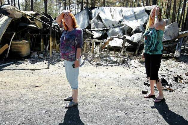 Wanda Cox, 65, and daughter Kim Suter, 28, look over Cox's destroyed house in the Circle D subdivision after residents were allowed to return. Photo: Jerry Lara/glara@express-news.net / SAN ANTONIO EXPRESS-NEWS