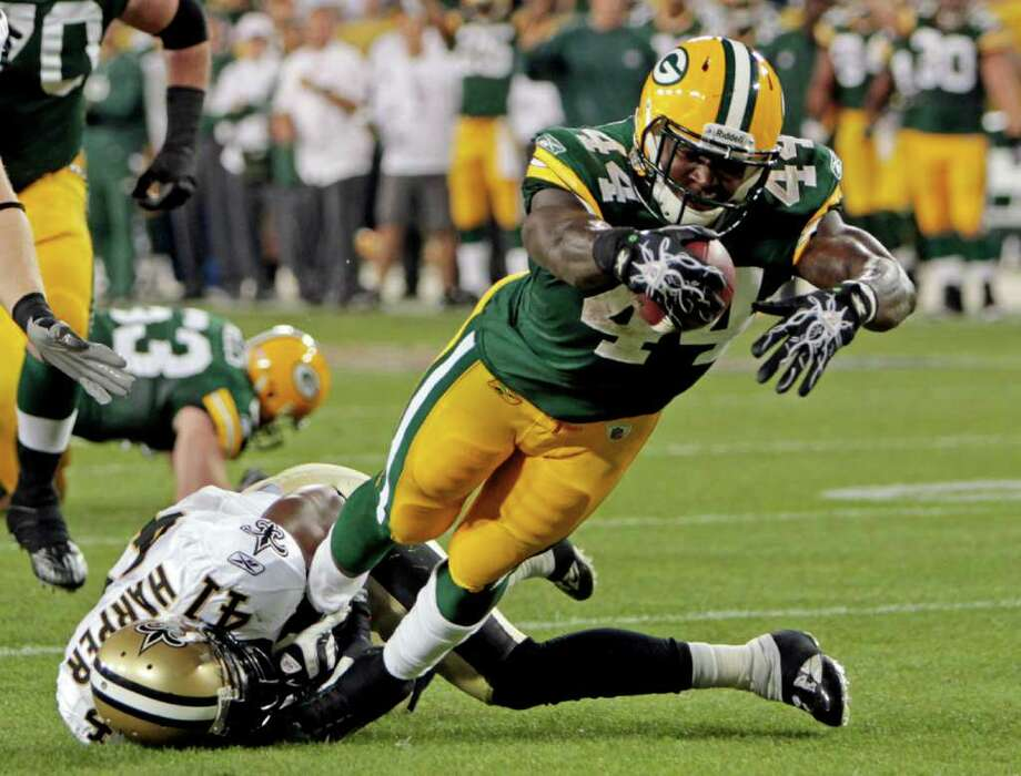 New Orleans Saints' Roman Harper (41) can't stop Green Bay Packers' James Starks (44) from diving into the end zone for a touchdown run during the first half of an NFL football game Thursday, Sept. 8, 2011, in Green Bay, Wis. (AP Photo/Mike Roemer) Photo: Mike Roemer