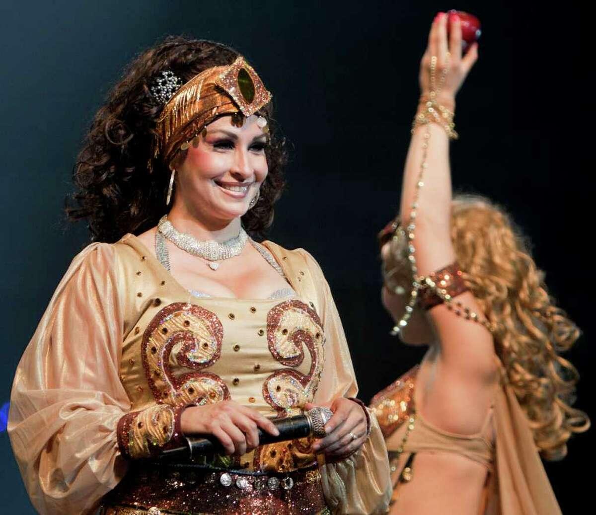 Audrey Alvarado performs as the ringmaster of the Alzafar Shrine Circus at Freeman Coliseum on Thursday, Sept. 8, 2011.