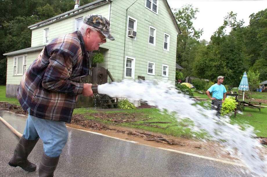 Michael Groff pumps the water out of the basement of his home in York, Pa., Thursday, Sept. 8, 2011. Days of rainfall from what had been Tropical Storm Lee inundated a wide portion of Pennsylvania and other northeastern states this week, forcing tens of thousands of people to seek higher ground, while pouring into basements and low-lying homes, leaving at least four dead and triggering fears about the adequacy of flood control systems. Photo: Jason Plotkin, AP / York Daily Record