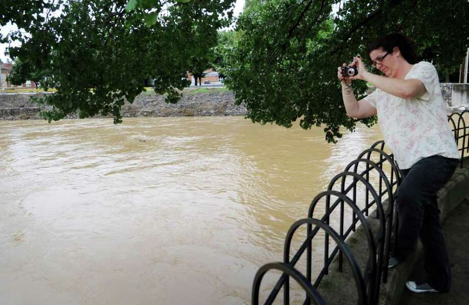 m Moore of York takes a photo of the rising Codorus Creek at Foundry Park in York, Pa., Thursday, Sept. 8, 2011. Days of rainfall from what had been Tropical Storm Lee inundated a wide portion of Pennsylvania and other northeastern states this week, forcing tens of thousands of people to seek higher ground, while pouring into basements and low-lying homes, leaving at least four dead and triggering fears about the adequacy of flood control systems. Photo: Kate Penna, AP / York Daily Record