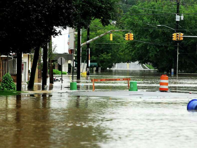 Water floods Luzerne Ave. Thursday, Sept. 8, 2011 in West Pittston, Pa. The remnants of Tropical Sto