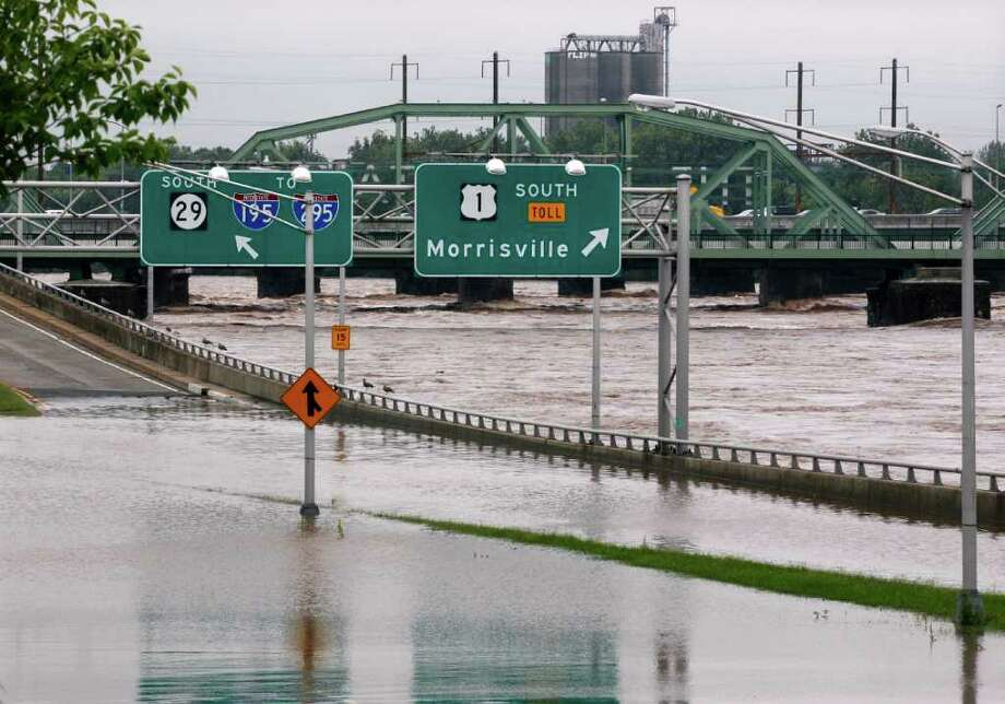 The area's major north-south highway, Route 29, is flooded Thursday, Sept. 8, 2011, in Trenton, N.J., as the Delaware River continues to rise. Remnants from tropical Storm Lee continue to produce heavy rain that could force flood-weary New Jerseyans to head for higher ground Thursday. Photo: Mel Evans, AP / AP