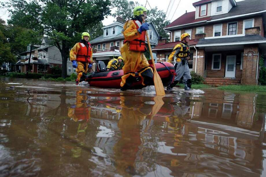 A rescue crew works through a neighborhood of flooded streets Thursday, Sept. 8, 2011, in  the Island section of Trenton, N.J., as the Delaware River continues to rise. Remnants from tropical Storm Lee continue to produce heavy rain that could force flood-weary New Jerseyans to head for higher ground Thursday. Photo: Mel Evans, AP / AP