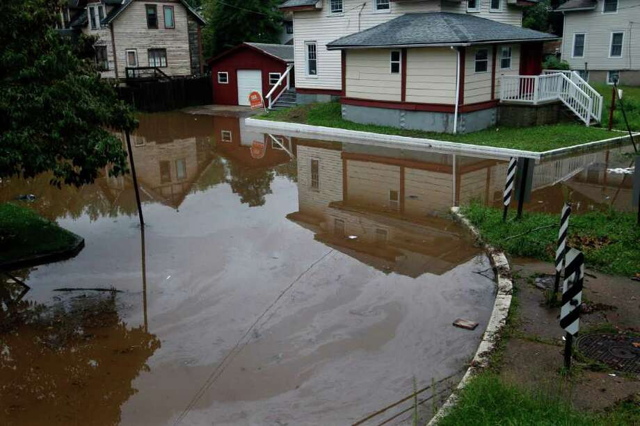 A house sits surrounded by oil-fouled water Thursday, Sept. 8, 2011, in  the Island section of Trenton, N.J., as the Delaware River continues to rise. Remnants from tropical Storm Lee continue to produce heavy rain that could force flood-weary New Jerseyans to head for higher ground Thursday. Photo: Mel Evans, AP / AP
