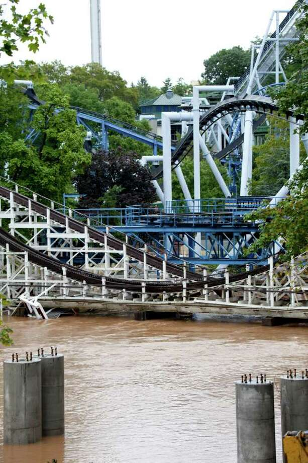 The floodwater of Spring Creek at Hershey Pa. are rising, coming dangerously close to the roller coasters in Hershey Park Thursday, Sept. 08, 2011.  Up to 70,000 people from the area inundated by Hurricane Agnes nearly four decades ago were ordered to evacuate Thursday as widespread flooding brought on by the remnants of Tropical Storm Lee lashed on already waterlogged Pennsylvania and was blamed for four deaths. Photo: Daniel Shanken, AP / FR92337 AP