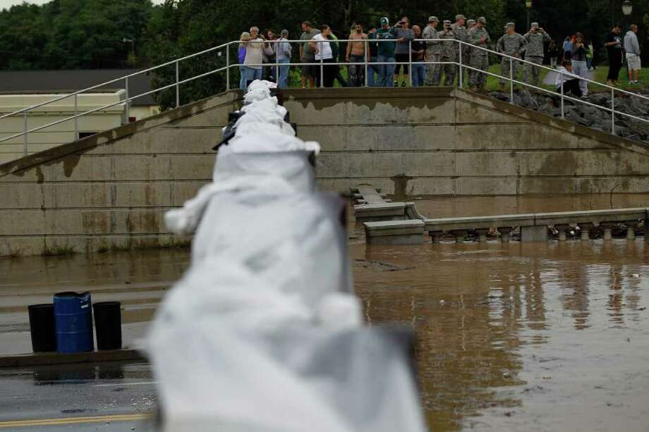 A floodgate holds back the swollen Susquehanna River, Thursday, Sept. 8, 2011, in Kingston, Pa. Widespread flooding brought on by the remnants of Tropical Storm Lee was being blamed for two deaths in Pennsylvania, where inundated communities were evacuated and state offices closed down on Thursday because of the rising waters. Photo: Matt Rourke, AP / AP