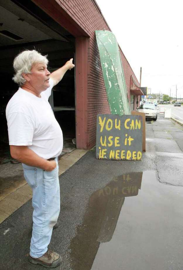 Jim Verdekal, of Pittston, Pa. shows his boat he says he used in the Agnes Flood of '72 on  Thursday, Sept. 8, 2011.    Nearly 100,000 people from New York to Maryland were ordered to flee the rising Susquehanna River on Thursday as the remnants of Tropical Storm Lee dumped more rain across the Northeast, closing major highways and socking areas still recovering from Hurricane Irene.  (AP Photo/The Citizens' Voice, Kristen Mullen)  MANDATORY CREDIT Photo: Kristen Mullen, AP / The Citizens' Voice