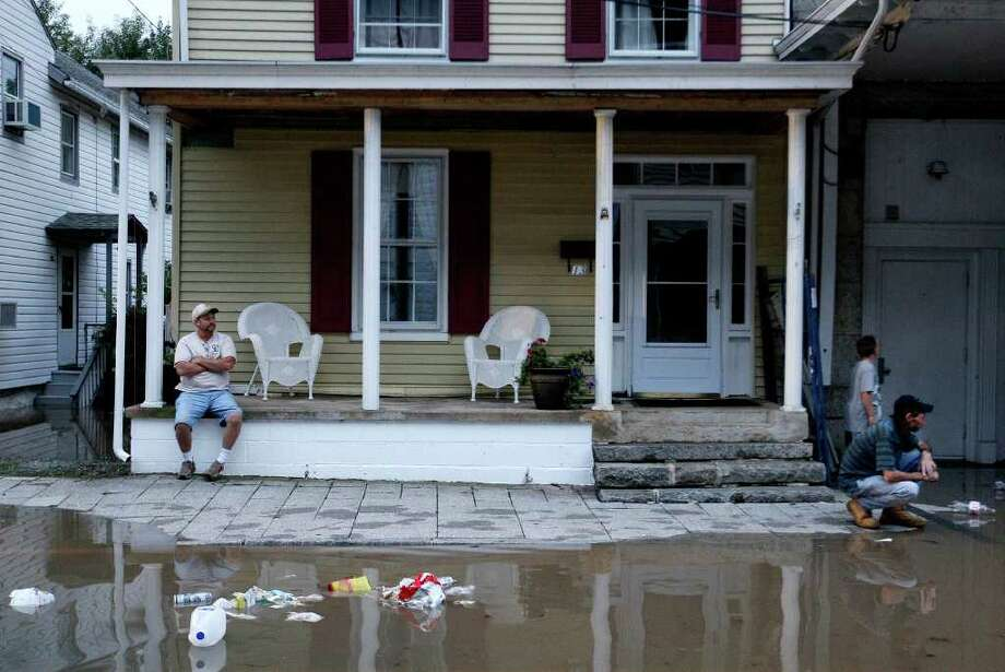People watch as water from the Susquehanna River, which is swollen with rain from the remnants of Tropical Storm Lee, continues to rise in Port Deposit, Md., Thursday, Sept. 8, 2011. Photo: Patrick Semansky, AP / AP