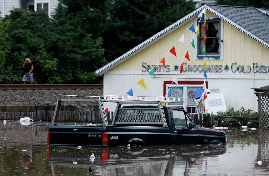 A partially submerged pickup truck sits in a parking lot in Port Deposit, Md., Thursday, Sept. 8, 2011, as the Susquehanna River, which is swollen with rain from the remnants of Tropical Storm Lee, continues to rise. Photo: Patrick Semansky, AP / AP