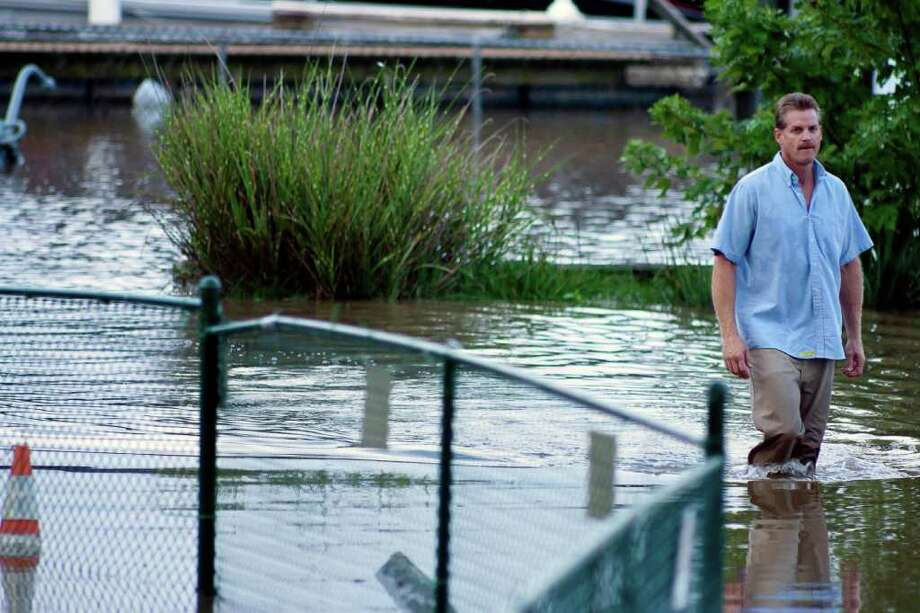 A man walks in flooded waters as the Susquehanna river rises around the American Legion property, Thursday, Sept. 8, 2011 in Havre De Grace, Md. Flooding from the remnants of Tropical Storm Lee drove hundreds of Maryland residents from their homes Thursday and claimed at least one life less than two weeks after Hurricane Irene soaked the national capital region. Photo: Saquan Stimpson, AP / ©The News Journal2011/SAQUAN STIMPSON, all rights reserved