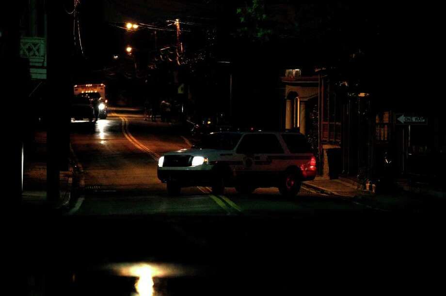 A fire department vehicle turns onto a nearly deserted street in Port Deposit, Md., Thursday, Sept. 8, 2011, as the Susquehanna River, which is swollen with rain from the remnants of Tropical Storm Lee, continues to rise. Photo: Patrick Semansky, AP / AP
