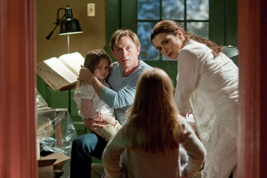 "(L-R) Claire Geare as Dee Dee, Daniel Craig as Will Atenton and Rachel Weisz as Libby Atenton in ""Dream House."" Photo: George Kraychyk / 2011 Universal Studios"