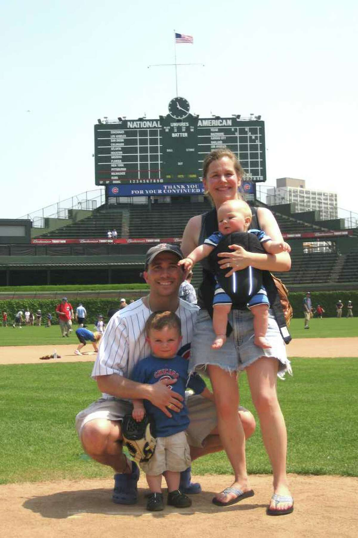 Jim Colpi, 33, with his family at Wrigley Field in Chicago, where they now live. Colpi escaped 2 World Trade Center, where he worked for Morgan Stanley, on Sept. 11, 2001.