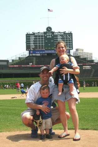 Jim Colpi, 33, with his family at Wrigley Field in Chicago, where they now live. Colpi escaped 2 World Trade Center, where he worked for Morgan Stanley, on Sept. 11, 2001. Photo: Contributed Photo