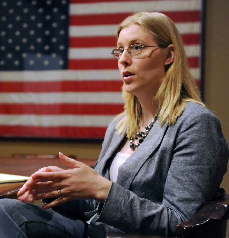 Attorney Kristan Exner talks in her Danbury office about her experiences working at the World Trade Center the day terrorists attacked, Sept. 11, 2001. Photo: Carol Kaliff