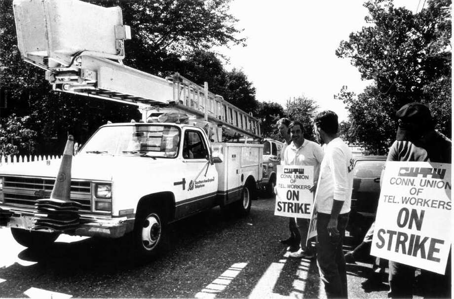 Sept. 15, 1986: Striking telephone workers at the Southern New England Telephone Co. facility on Courtland Avenue in Stamford watch as non-striking supervisors take out work trucks. The strike was in its third day. Photo: File Photo