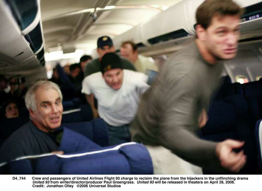 Crew and passengers of United Airlines Flight 93 charge to reclaim the plane from the hijackers in the unflinching drama United 93 from writer/director/producer Paul Greengrass.  United 93 will be released in theaters on April 28, 2006.   Credit:  Jonathan Olley Photo: Jonathan Olley / handout