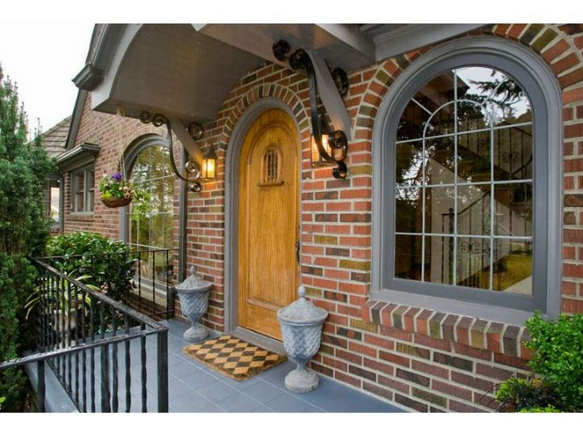 The entry of 915 W. Barrett St. The 3,500-square-foot house, built in 1927, has four bedrooms and three bathrooms, with huge, curved windows, exposed-wood moldings, window sills and doors, wrought-iron railings, built-in cabinets, marble-and-tile bathrooms and a finished lower level with a wine cellar. The 6,000-square-foot lot also has a two-car garage, treehouse and patio. It's listed for $1.13 million.