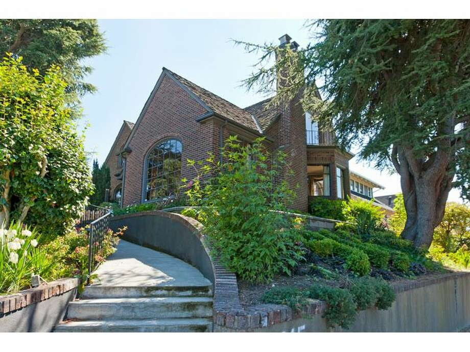 Here's a brick Tudor house with tons of character in Queen Anne, at 915 W. Barrett St. The 3,500-square-foot house, built in 1927, has four bedrooms and three bathrooms, with huge, curved windows, exposed-wood moldings, window sills and doors, wrought-iron railings, built-in cabinets, marble-and-tile bathrooms and a finished lower level with a wine cellar. The 6,000-square-foot lot also has a two-car garage, treehouse and patio. It's listed for $1.13 million. Photo: Windermere Real Estate