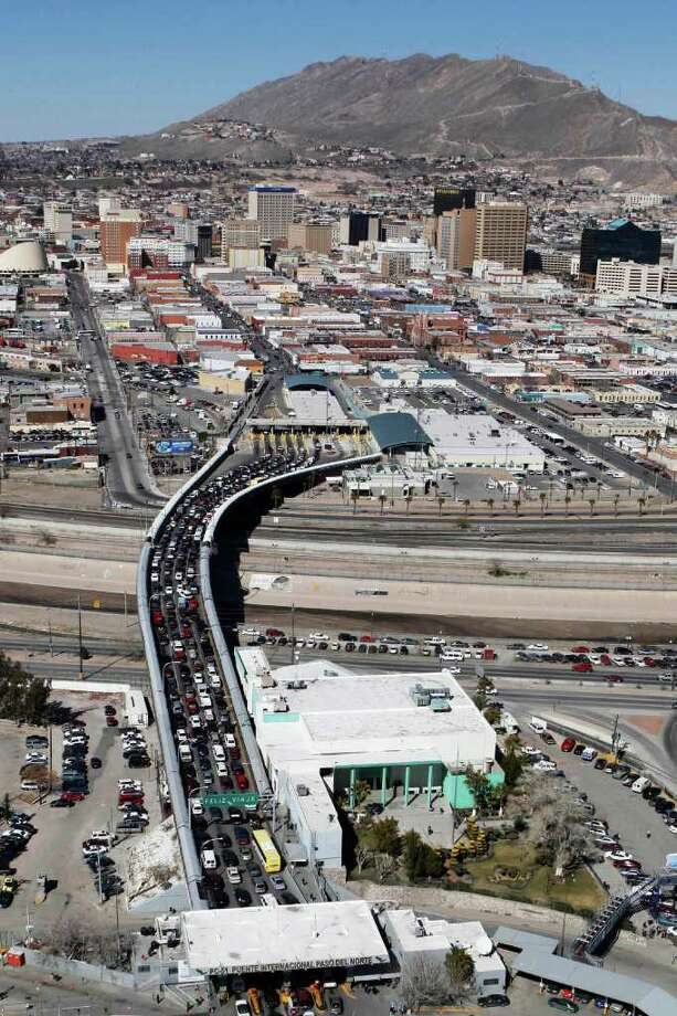 This picture taken from a helicopter shows a view of Santa Fe bridge that links the Mexican city of Ciudad Juarez, bottom, with the U.S. city of El Paso, Tuesday, Feb. 16, 2010. Beheadings, kidnappings and daylight shootings have become common in the border cities of Tijuana and Ciudad Juarez as drug cartels fight over smuggling routes into the United States. (AP Photo/Alexandre Meneghini) Photo: Alexandre Meneghini, ASSOCIATED PRESS / AP2010