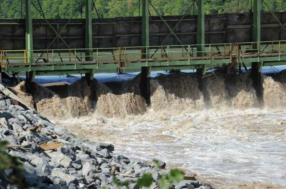 Part of the bridge and land at Lock 9 on Bridge Street in Rotterdam Junction , N.Y. has washed away from the Mohawk River flooding on Sept. 9, 2011. Here water rushes under the bridge on the other end of the damaged bridge. (Lori Van Buren / Times Union) Photo: Lori Van Buren
