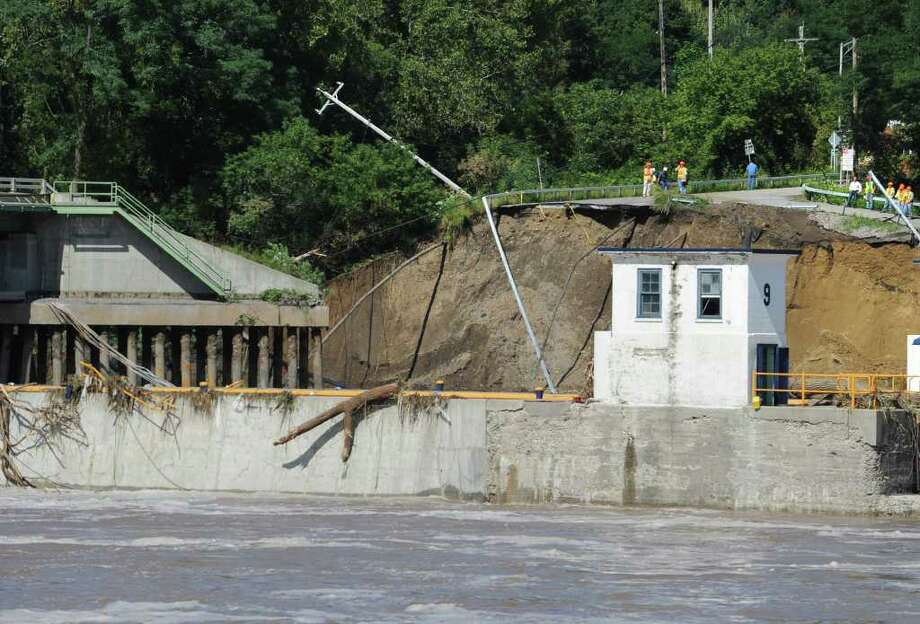 Part of the bridge and land at Lock 9 on Bridge Street in Rotterdam Junction , N.Y. has washed away from the Mohawk River flooding on Sept. 9, 2011. (Lori Van Buren / Times Union) Photo: Lori Van Buren
