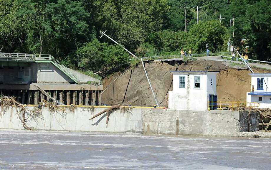 Part of the bridge and land at Lock 9 on Bridge St. to in Rotterdam Junction , N.Y. has washed away from the Mohawk River flooding on Sept. 9, 2011. (Lori Van Buren / Times Union) Photo: Lori Van Buren